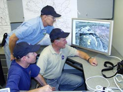 image of some nasa team members at fire command post