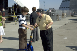 Steve Wozniak teaches Jack Boyd's grandson how to use his Segway.  Photo Credit:  NASA Ames Research Center / John Schultz
