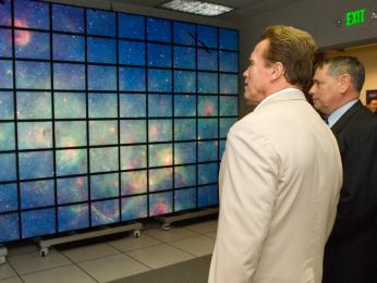 California Gov. Arnold Schwarzenegger and NASA Ames Research Center Director S. Pete Worden examine hyperwall-2, a state-of-the-art visualization system developed at Ames. Hyperwall-2 is one of the largest displays in the world and is used by scientists for data interpretation. Schwarzenegger visited Ames July 14, 2008, for a behind-the-scenes tour and briefings about NASA's support to firefighters battling California wildfires. Ames scientists are partnering with colleagues at Dryden Flight Research Center, Edwards, Calif., to send NASA's remotely piloted Ikhana aircraft on reconnaissance flights using sophisticated visual and thermal sensors to provide up-to-the-minute information to firefighters in the field. Photo Credit: NASA Ames Research Center / Eric James