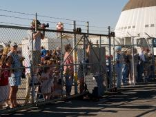 Image of crowd gathered at NASA Ames Reearch Center to see Zeppelin arrive.