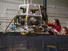 Engineers preparing the Hover Test Vehicle for ground tests (pictured are Eleanor Crane of Stanford University and Chris Boshuizen of NASA Ames Research Center/Logyx)