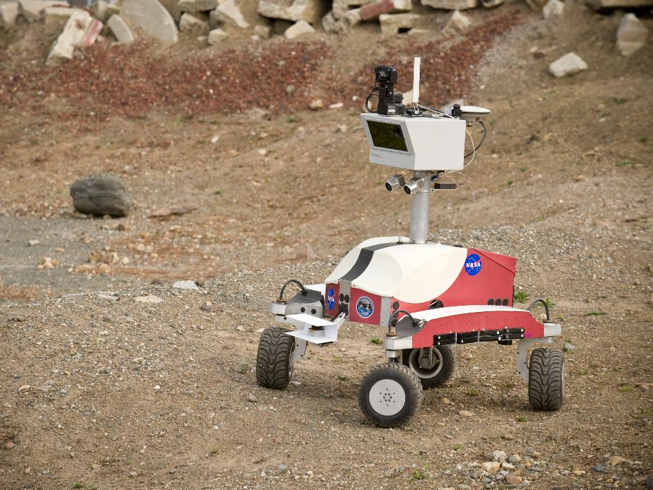 The K10 Red planetary rover scouts the Marscape at NASA's Ames Research Center with a 3-D laser scanner, color panoramic camera and high-resolution terrain imager.