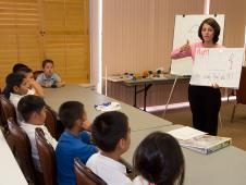 PSTI Participant gives a math lesson to elementary students.