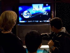 School children viewing a NASA interactive exhibit.