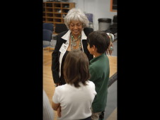 Nichelle Nichols and visiting school children.