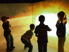 Image of kids at the traveling space museum exhibit.