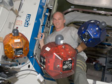 ISS022-E-006355: Astronaut Jeffrey Williams with SPHERES