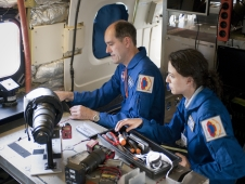 Project scientist Peter Jenniskens of the SETI Institute and NASA's Ames Research Center and Christina Giannopapa of the Netherlands' Eindhoven University prepare lenses for one of the specialized cameras for installation on NASA's DC-8 flying laboratory.