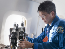 Hideyuki Tanno, of the Japan Aerospace Exploration Kakuda Space Center prepares instruments aboard NASA's DC-8 flying laboratory.