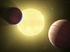 Artist's concept of two Saturn-sized planets.
