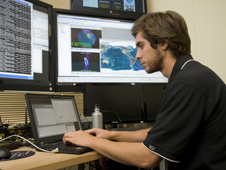 Anthony Young works in the Mission Operations Center at Santa Clara University, Santa Clara, Calif., in support of NASA's Organism/Organic Exposure to Orbital Stresses (O/OREOS) nanosatellite.