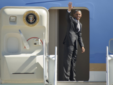 President Obama waves before departing Moffett Field.
