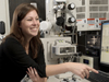 Jessica Koehne at a scanning electron microscope