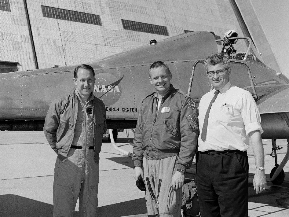 Ames test pilot Fred Drinkwater, astronaut Neil Armstrong, and Ames project engineer Stu Rolls in front of the Ames Bell X-14 airplane being flown by Armstrong in February of 1964, five years before Armstrong landed on the moon.