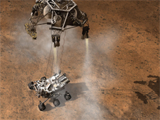 Artist¹s conception of the moment that NASA¹s Curiosity rover touched down on Mars, suspended on a bridle beneath the spacecraft¹s descent stage.