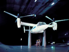 XV-15 tiltrotor aircraft in 40x80foot wind tunnel in  helicopter (take-off) mode.