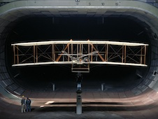 A replica of the wright brothers' plane being tested in the 40- by 80-ft tunnel.