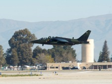 Alpha jet takes off with backdrop California mountains