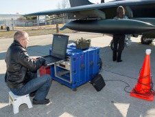 Ames researchers study data in front of jet.