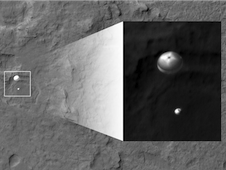 The curiosity rover with parachute deployed during its decent towards the Martian surface.