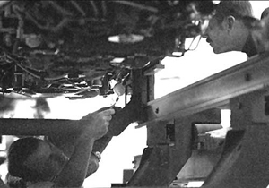 Paul Everhart, at left, and Walt Chase work on F-15 No. 837.