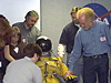 Edwards Middle School teachers (clockwise from lower left) Terri Hyatte, Jennie Sparks, Barry Conforti, Chris Richards and Jay Blank examine a high-altitude pressure suit during their tour of NASA Dryden.