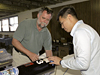 Scott Bartel of Blacksky Corp. and Trong Bui install the rocket data acquisition system