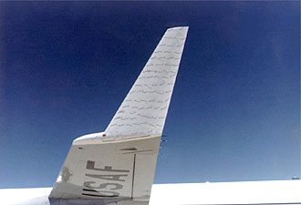 Close-up of winglet on KC-135 test aircraft, with attached tufts displaying flow of air over winglet surface
