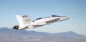 The F/A-18 Active Aeroelastic Wing executes a Phase 2 flight over Mojave terrain. NASA Photo by Jim Ross