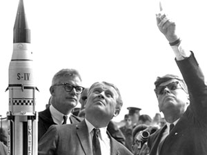 Dr. Wernher von Braun, center, explains the Saturn launch system to President John F. Kennedy on Nov. 16, 1963, at Cape Canaveral, Fla. NASA Deputy Administrator Robert Seamans is at left of von Braun. Image provided by James B. Hill, audiovisual archivist at the John Fitzgerald Kennedy Library in Boston, Mass. NASA Photo