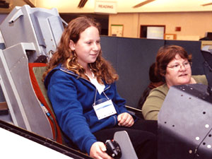 Rebecca Mittenthal, 13, tries her hand at landing an F/A-18 in Dryden's flight simulator.