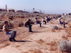 Dryden volunteers sit beneath the flight path where an F/A-18 created a sonic boom. The 18 volunteers were helping researchers to determine whether detailed recordings of the sonic boom could be used to accurately simulate the real thing. NASA Photo By Tom Tschida