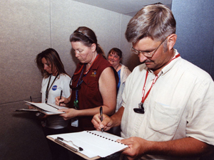 At front, from left, Dryden volunteers Candace Mertes, Liz Kiffling and Kirk Caldwell take notes during the experiment. Pennsylvania State University researcher Kathy Hogdon is in the background. NASA Photo By Tom Tschida