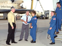 From left, Dryden Deputy Director Steve Schmidt and Dryden Shuttle Program Manager Joe D'Agostino greet Discovery Commander Eileen Collins and the crew.