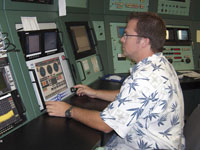 Bob Guere operates the supporting S-band telemetry and downlinked video console, one of many shuttle-related duties for WATR employees.