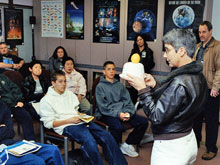 Marta Bohn-Meyer demonstrates aeronautical principles for students at the 2003 Math and Science Odyssey. Among the many activities to which Bohn-Meyer devoted her time was work in the educational environment with students - particularly young girls - interested in pursuing technical career fields.