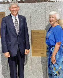 Former Dryden research pilot Ed Schneider and his wife Ginger flank the latest honor bestowed on