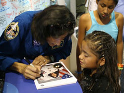 Williams autographs her photo for a potential future astronaut.