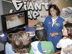 NASA astronaut Suni Williams detailed her launch on the space shuttle for a group of young admirers during her appearance at the NASA exhibit at the X-Games in suburban Los Angeles Aug. 4