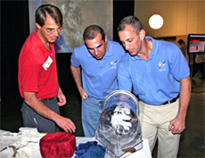 An astronaut glove prototype gets a tryout by STS-118 astronauts.