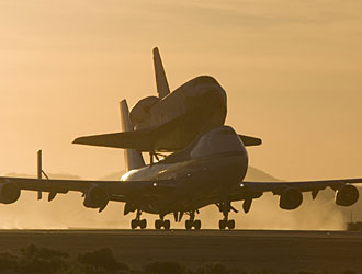 A NASA 747 Shuttle Carrier Aircraft departs with space shuttle Atlantis securely on top for its return to Kennedy Space Center, Fla.