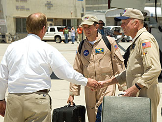 SOFIA Program Manager Bob Meyer, far left, welcomes Dryden pilot Bill Brockett, center, and chief SOFIA pilot Gordon Fullerton to Dryden.