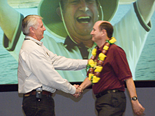 Larry Schilling shaking hands with Deputy Center Director Steve Schmidt