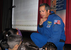 Former Astronaut John Herrington speaks to students.