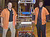 NASA Dryden engineer and robotics team mentor Dave Voracek with his son Brad during unveiling of Lancaster High School's entry in the FIRST robotics competition.
