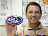 NASA Dryden pilot and artist Mark Pestana displays the STS-123 patch he designed.