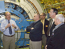 SOFIA Program Manager Bob Meyer, at left, explains details of the flying infrared observatory.
