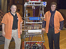 Dryden engineer Dave Voracek, left, and his son Brad are pictured at the Feb. 15 unveiling of Lancaster High School's entry,