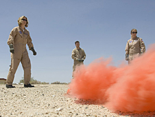 NASA Dryden videographers Lori Losey and Brian Soukup and flight test engineer Syri Koelfgen practice activating flares during land survival training recently at Edwards Air Force Base.