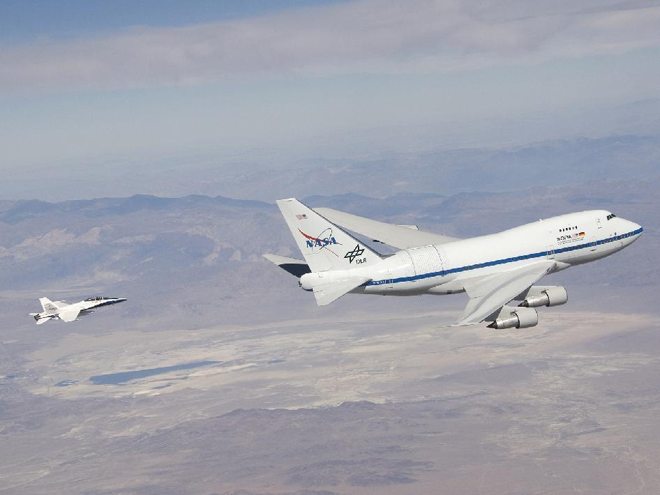 NASA's SOFIA infrared observatory and F/A-18 safety chase during the first series of test flights to verify the flight performance of the modified Boeing 747SP.
